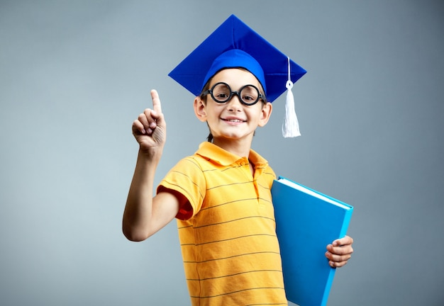 Smart student holding a file Free Photo