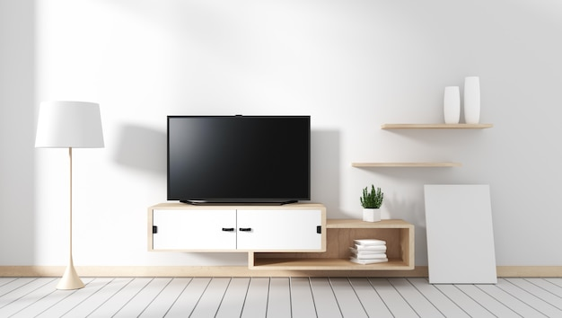 Smart tv - blank black screen hanging on the cabinet, room with white wood floor. Premium Photo