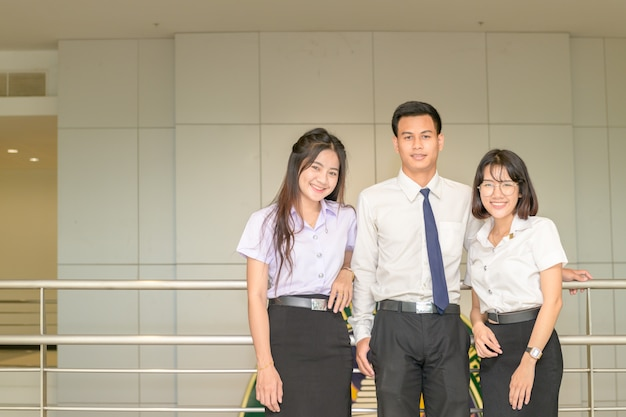 Smart young students standing together Premium Photo