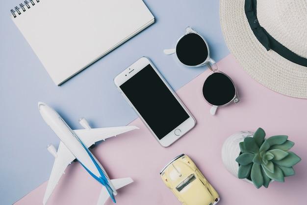 Smartphone amidst trip supplies Free Photo