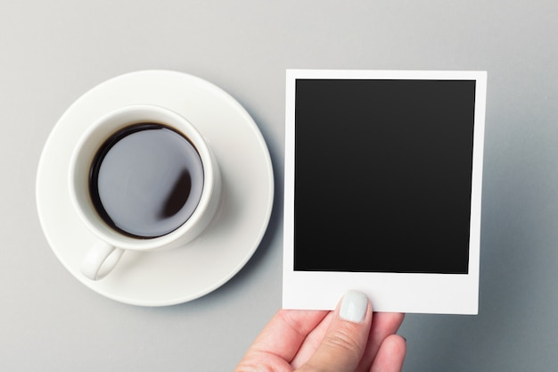 Smartphone beside of coffee on wooden table. Premium Photo