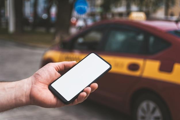 Smartphone in hand Premium Photo