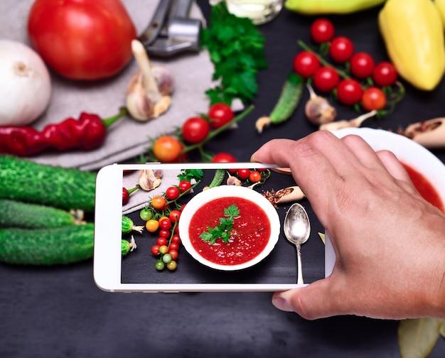 Smartphone in the human hand Premium Photo
