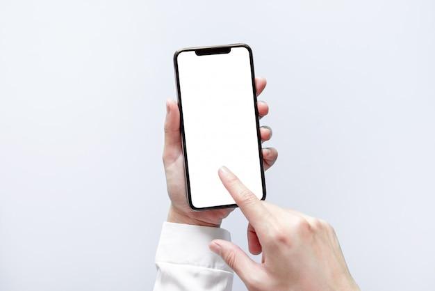 스마트 폰 모형. 검은 전화 흰색 화면을 사용 하여 실업 손 프리미엄 사진