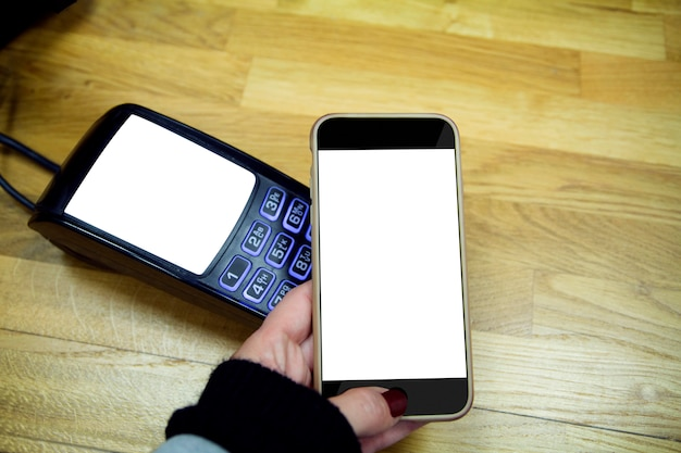 Smartphone and payment terminal isolated Premium Photo