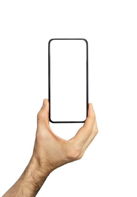 Смартфон (телефон) пустой экран в руке. черный смартфон на белом фоне. пустой экран телефона для изображения и дизайна Premium Фотографии