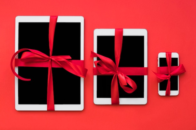 Smartphone and tablets with ribbons Free Photo