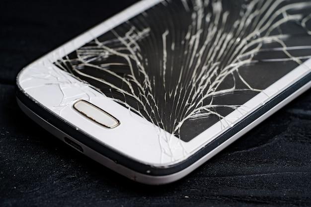 Smartphone with broken screen. close-up. Premium Photo