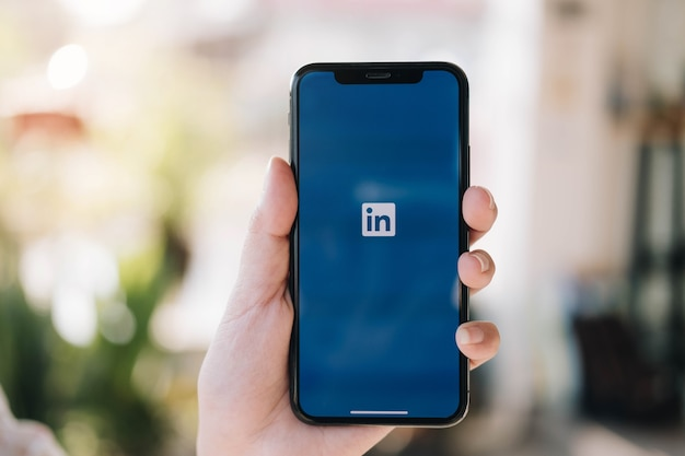 Smartphone with linkedin application on the screen. linkedin is a business-oriented social networking service. Premium Photo