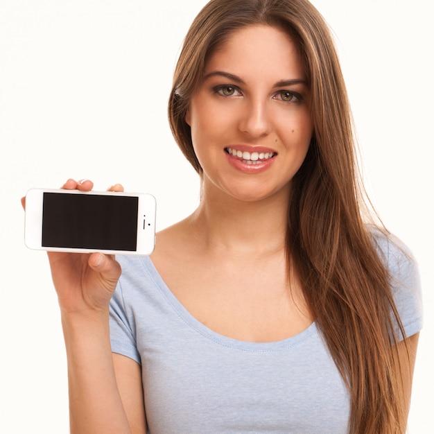 Молодая кавказская женщина с smartphone Бесплатные Фотографии