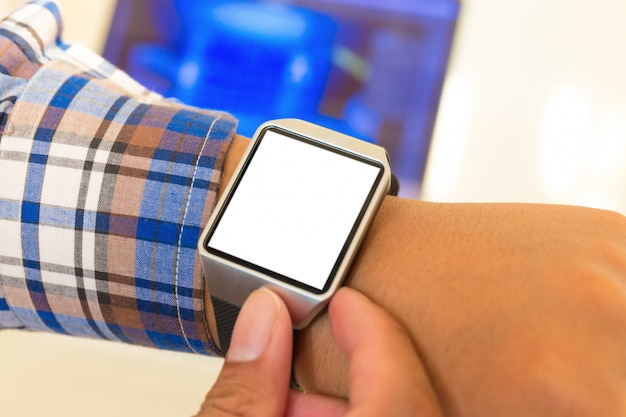 Smartwatch of businessman hands with with blank screen. Premium Photo
