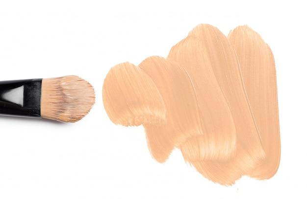 Smeared foundation natural make up on white Premium Photo