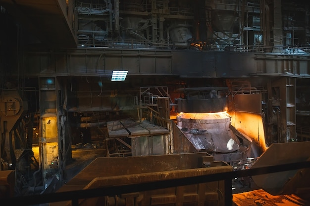 Smelting of the metal in the foundry Premium Photo