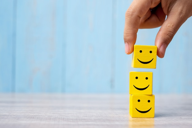 Smile face on yellow wood cube