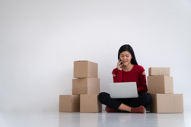 Smile for sales success after checking order from online shopping store at home office Premium Photo