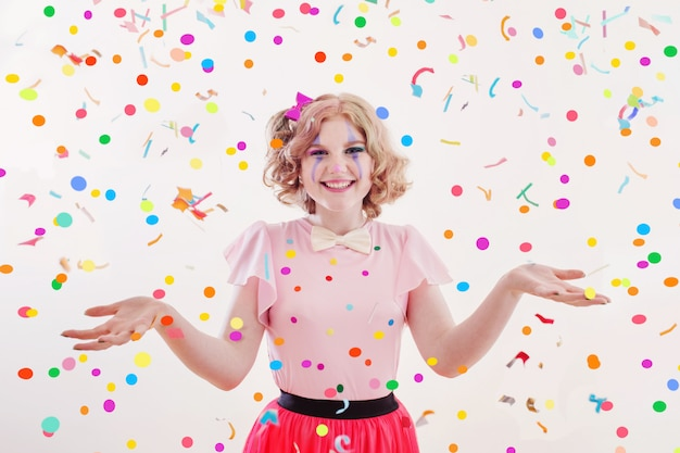 Smile teenager girl in clown costume isolated on white Premium Photo