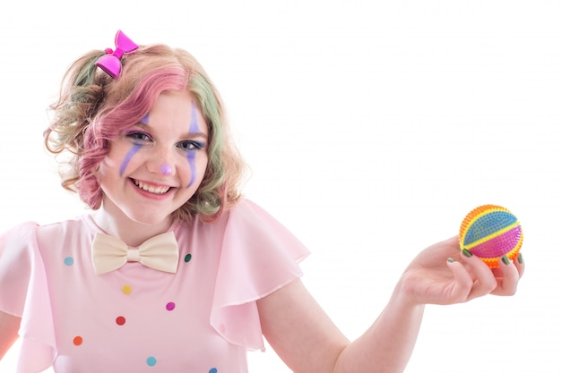 Smile teenager girl in clown costume with ball  isolated on white Premium Photo
