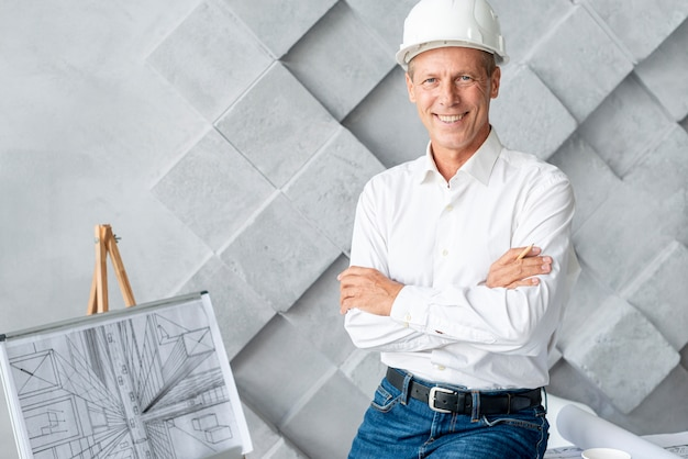 Smiley architect posing at the office Free Photo