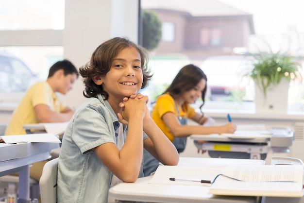 Smiley childrens in classroom Free Photo