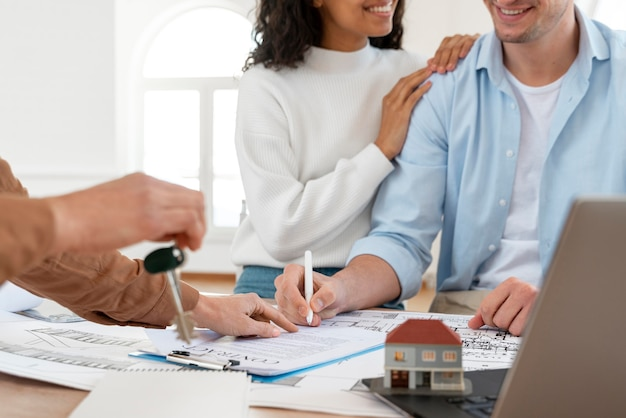 Smiley couple signing contract for new house Free Photo
