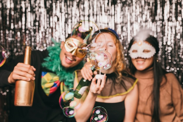 Smiley friends having fun at carnival party Free Photo