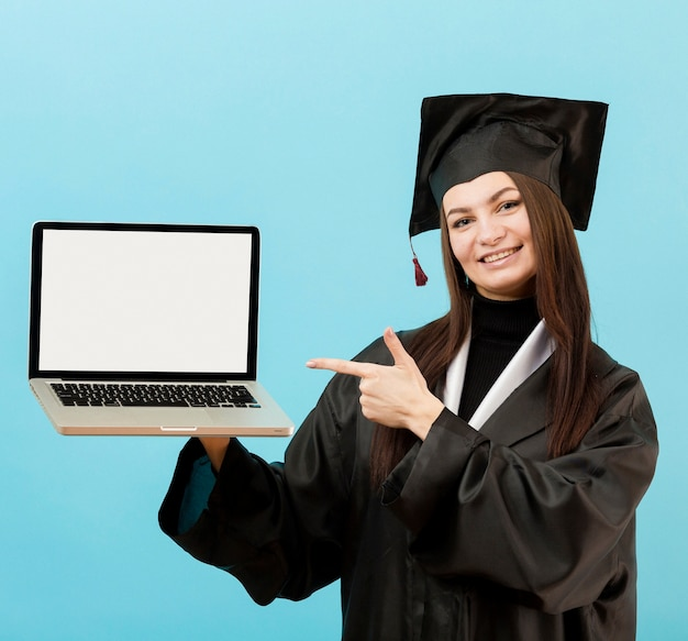 Smiley girl holding laptop Premium Photo