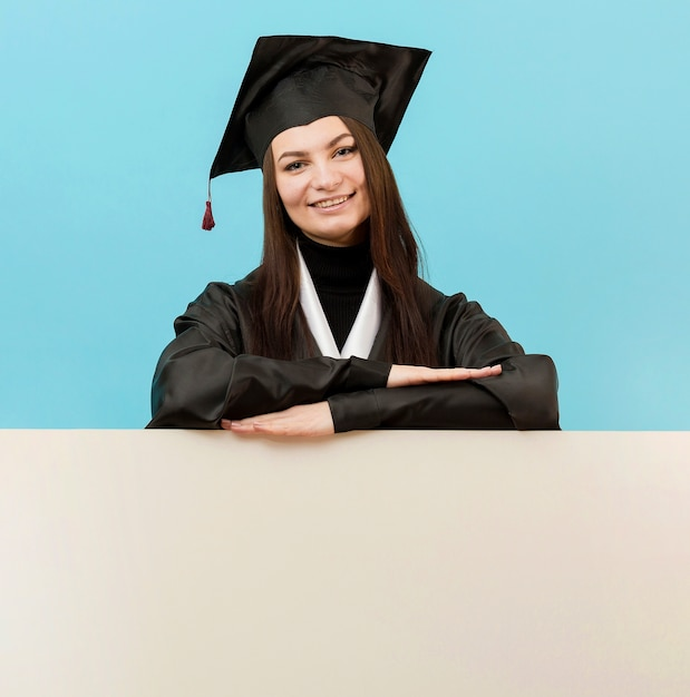 Smiley girl posing with placard Free Photo