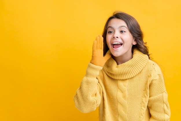Smiley girl wearing winter clothes copy-space Free Photo