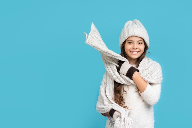 Smiley girl in winter clothing copy-space Free Photo