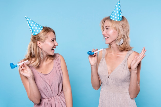 Smiley girlfriends at birthday party Free Photo