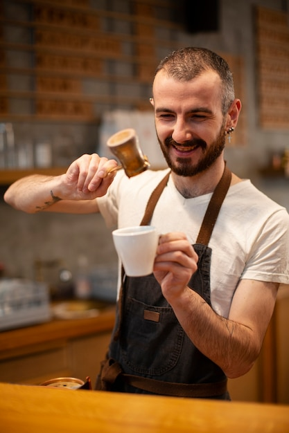 Smiley male employee of coffee shop Free Photo