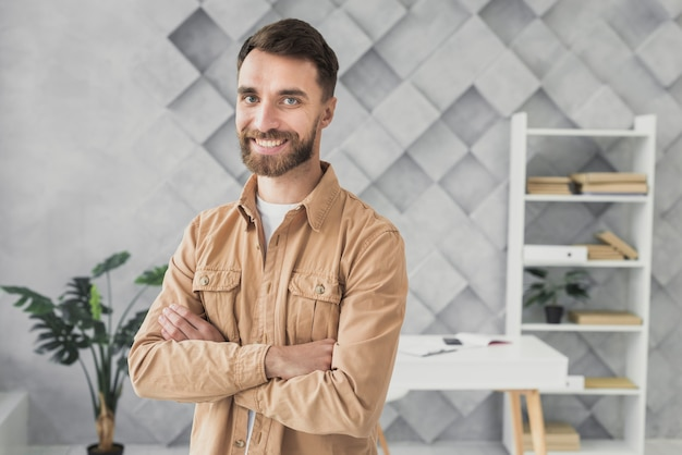 Smiley man standing in an office medium shot Free Photo