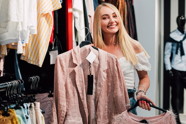 Smiley woman checking clothes Free Photo