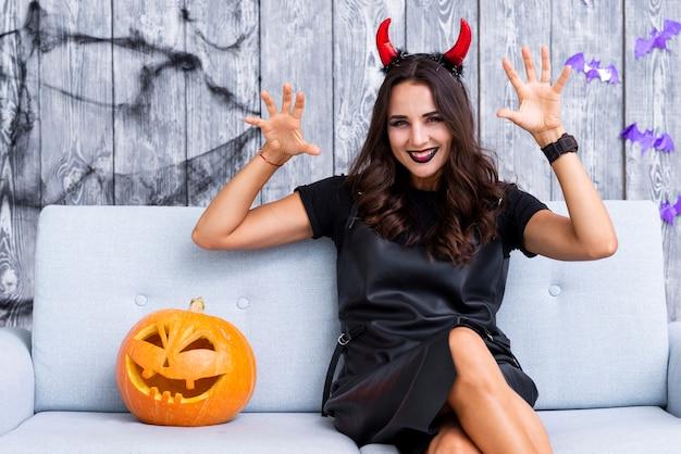 Smiley woman in halloween costume Free Photo