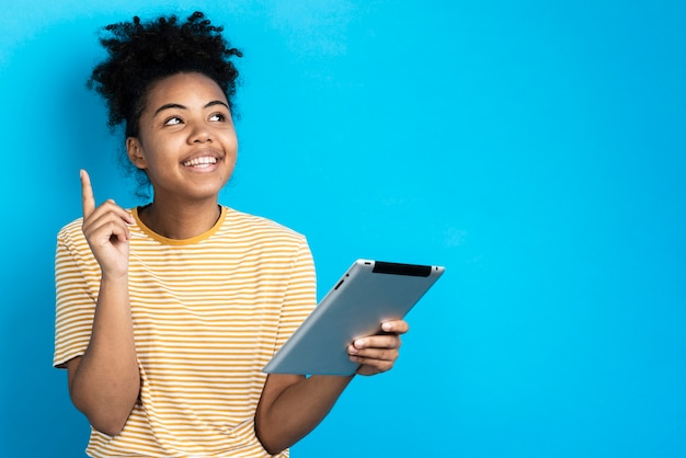 Smiley woman holding tablet Free Photo