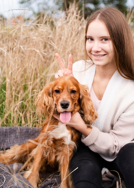 Smiley woman posing with her puppy Free Photo