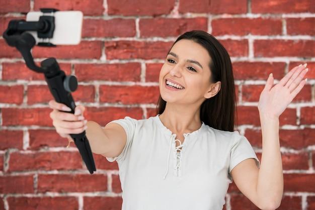 Smiley woman recording a video Free Photo