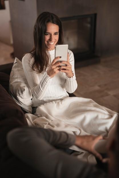 Smiley woman taking photos of boyfriend Free Photo