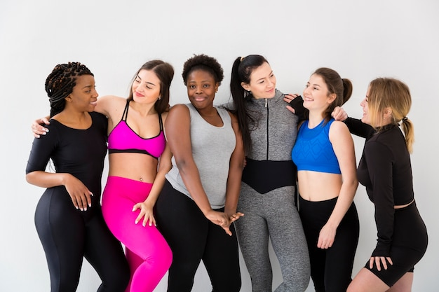 Smiley women on break from fitness class Free Photo