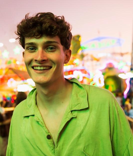 Smiley young man looking at camera Free Photo