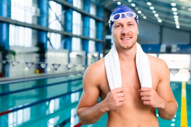 Smiley young man prepared to swim Free Photo