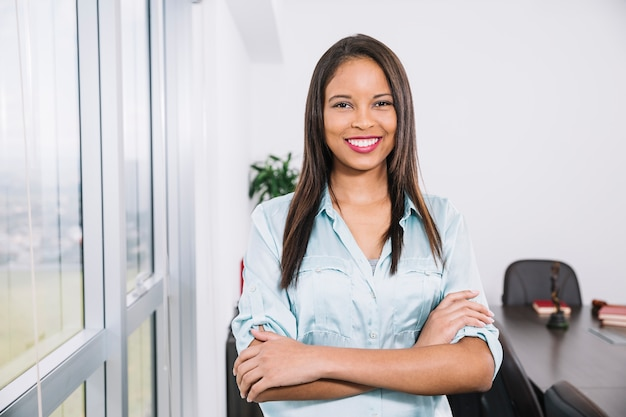 Smiling african american young lady near window Free Photo