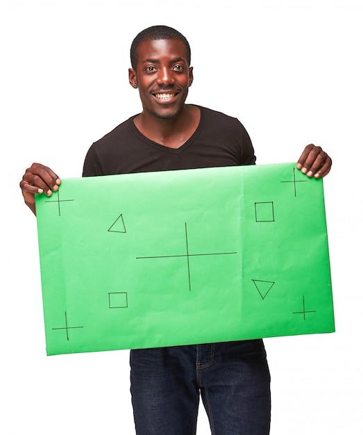 Smiling african man as black businessman with green panel Free Photo