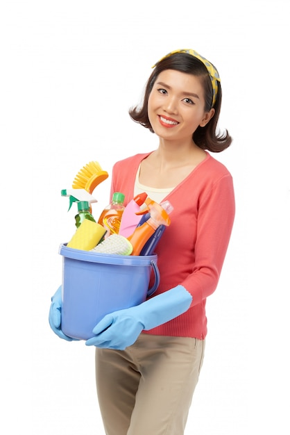 Smiling asian woman having spring clean Free Photo
