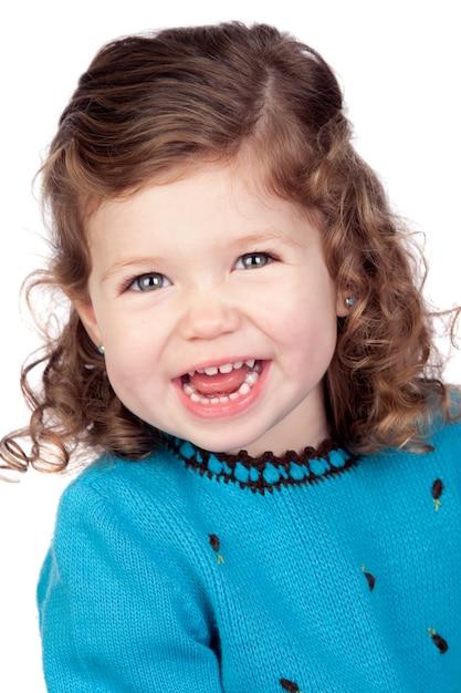 Smiling baby girl isolated over white background Premium Photo