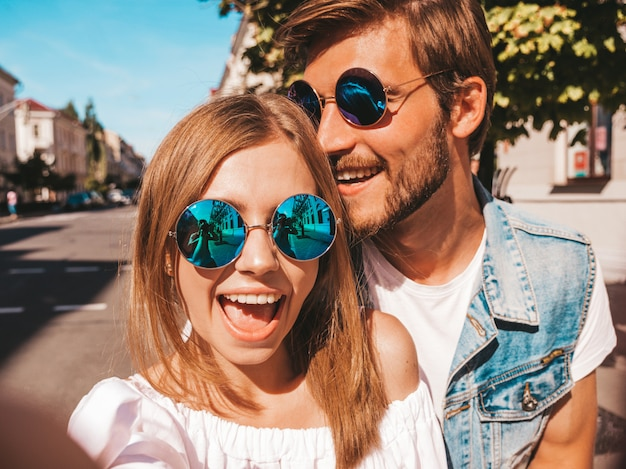 Smiling beautiful girl and her handsome boyfriend in casual summer clothes Free Photo
