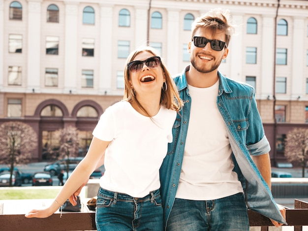 Smiling beautiful girl and her handsome boyfriend in casual summer clothes.   . Free Photo
