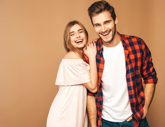Smiling beautiful girl and her handsome boyfriend laughing. Free Photo