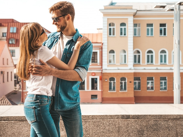 Smiling beautiful girl and her handsome boyfriend. woman in casual summer jeans clothes.    .looking at each other Free Photo