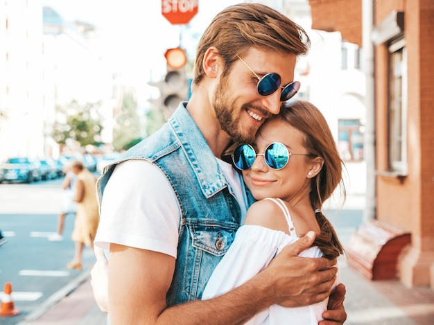 Smiling beautiful girl and her handsome boyfriend. Free Photo